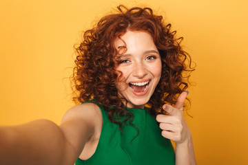 Close up portrait of a cheerful redhead woman in dress
