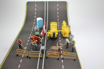 a mini team to repair street cracked , tiny figure