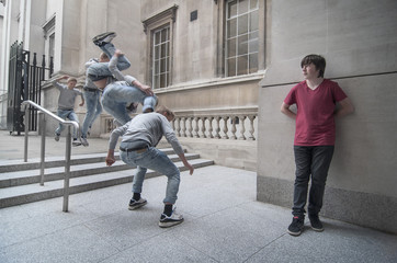 Free running parkour athlete jumping of stairs in public area, London, England