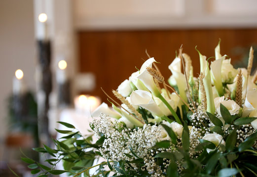 flowers on an altar in the church and the candles on background