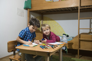Brothers enjoying with coloured pencils, Munich, Germany