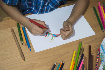 Close-up of a boy's hand colouring, Munich, Germany