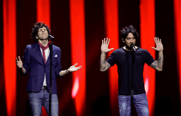 """Italy's Ermal Meta and Fabrizio Moro perform """"Non mi avete fatto niente"""" during the dress rehearsal of Semi-Final 2 for Eurovision Song Contest 2018 at the Altice Arena hall in Lisbon"""