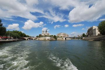 Notre Dame de Paris; waterway; sky; cloud; water