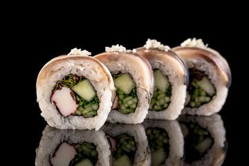 sushi rolls isolated on the black background