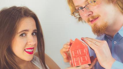 Happy couple buying new house