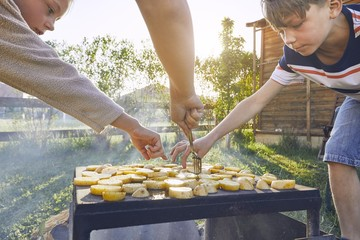 Children enjoy grilled