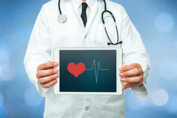 Doctor showing a digital tablet with heartbeat graphic on a blue background