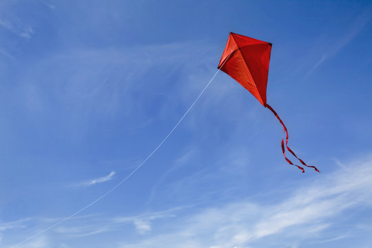 A red kite in the sky