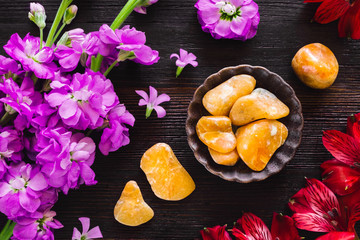 Orange Calcite with Gladiolus and Lily of the Incas