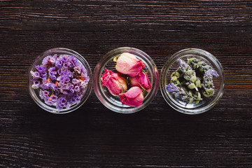 Bowls of Dried Flowers Aligned and Centered on Dark Table