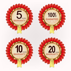 Round emblems with red ribbons, numbers and with guarantee text,