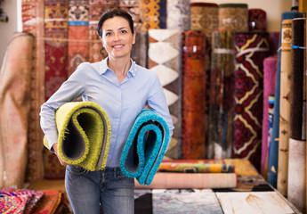 Adult woman buyer choosing colour carpets