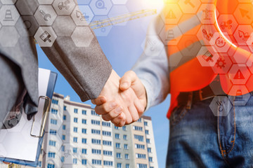 Builder and businesswoman sealed the deal with a handshake.
