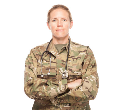 Female Army doctor in uniform looking serious.