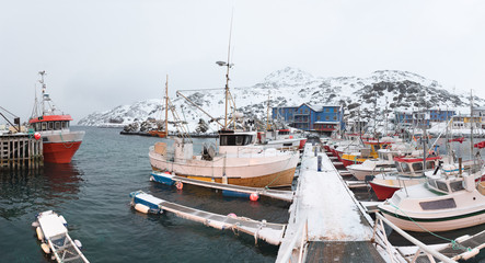 Fishing boats at harbor in winter, Nordkapp, Norway