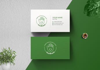 Business Card Layout with Smiley Face Hand Illustration