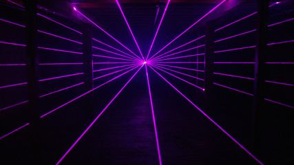 Thin purple laser beams shine past columns background