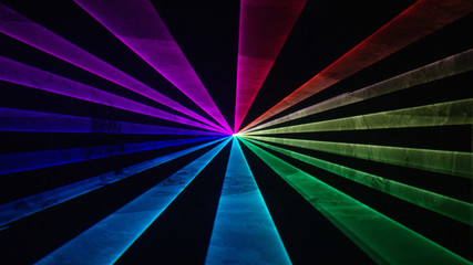 Wide rainbow laser beams on black background 3