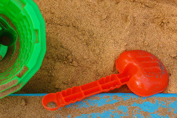 Children's shovel, bucket and sand