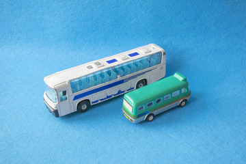 Scale models of colored small toy buses
