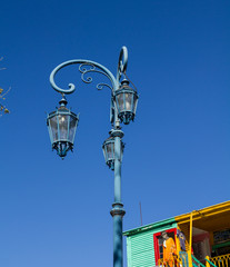 Streetlight with the colorful houses in Caminito.