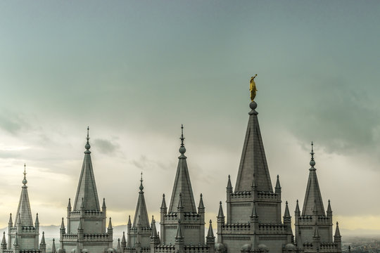 The Angel Moroni and spires of Salt Lake Temple on an overcast spring evening. The Church of Jesus Christ of Latter-day Saints, Temple Square, Salt Lake City, Utah, USA.