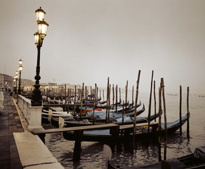 Gondolas moored at a waterfront, Venice, Italy.