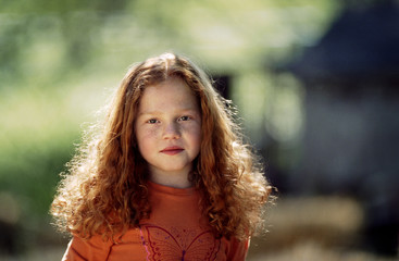Portrait of little girl with red hair