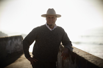 Man in cowboy hat by the beach