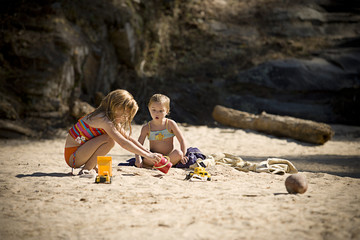 Sisters playing with beach toys