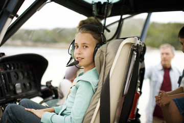 Portrait of a girl sitting in a helicopter.