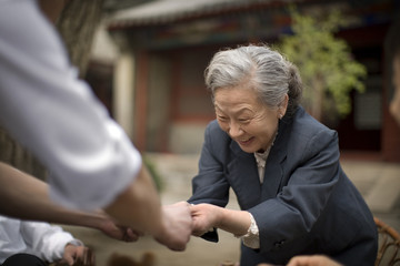 Smiling senior woman playing outdoors