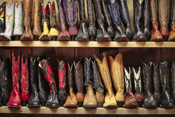 Rows of cowboy boots lined up on shelves.