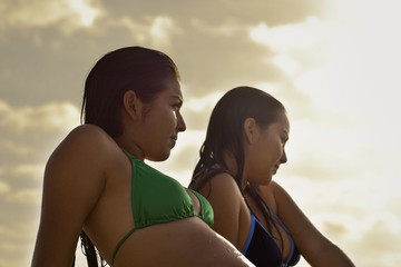 Two teenage girls relaxing in bikinis