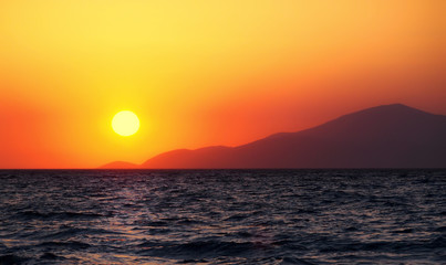beautiful glowing golden island sunset over the sea in Kos Greece