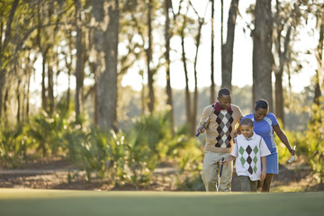 Family walking across golf course