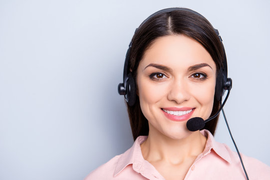 Portrait with copy space of cheerful positive cute woman in shirt with headset and microphone on her head looking at camera isolated on grey background advertisement concept