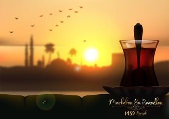 Marhaban ya Ramadhan. A cup of tea in beautiful sunset background