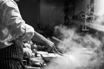 Chef is stirring