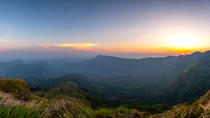 panoramic landscape beautiful mountain on sunset background and nature mist on forest , panorama Thailand