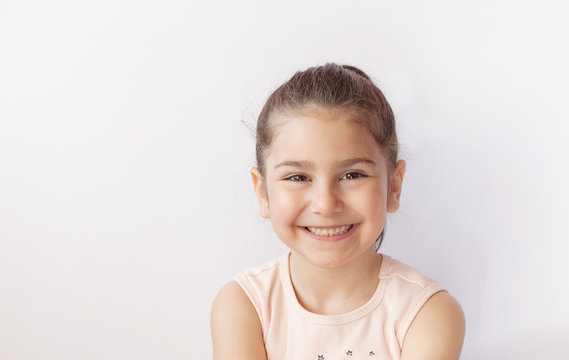 Portrait of a happy smiling child girl.