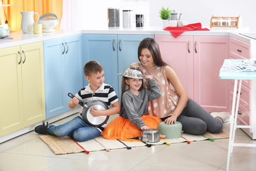 Family playing with kitchenware as musical band at home