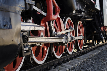 large red wheels of a locomotive