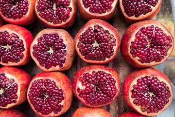 Background of opened pomegranates for sale at the city farmers market