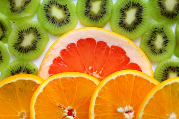 sliced KIWI fruit with a slice of grapefruit and oranges healthy eating