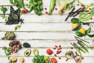 Wall Mural - Healthy raw summer vegan ingredients. Flat-lay of colorful vegetables and greens on white table background, top view, copy space. Clean eating, dietingm vegan, vegetarian party food
