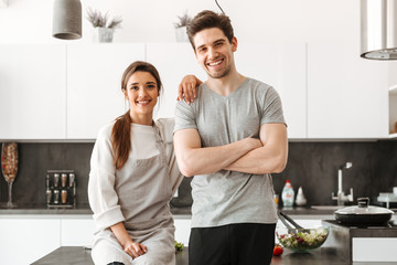 Portrait of a happy young couple at the kitchen