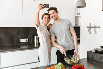 Portrait of a happy young couple taking a selfie
