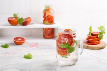 Detox infused water flavored with bloody orange and mint. Healthy refreshing beverage.